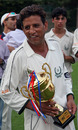 The smile of a champion - Ilyas Gull holds the Sunday League Grand Final Trophy