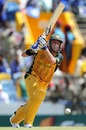 Michael Hussey plays the ball down the ground