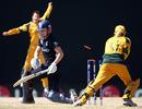 Beth Morgan of England is bowled by Shelley Nitschke as England's batting subsides, Australia  v England, ICC Women's World Twenty20, Basseterre, May 5 2010