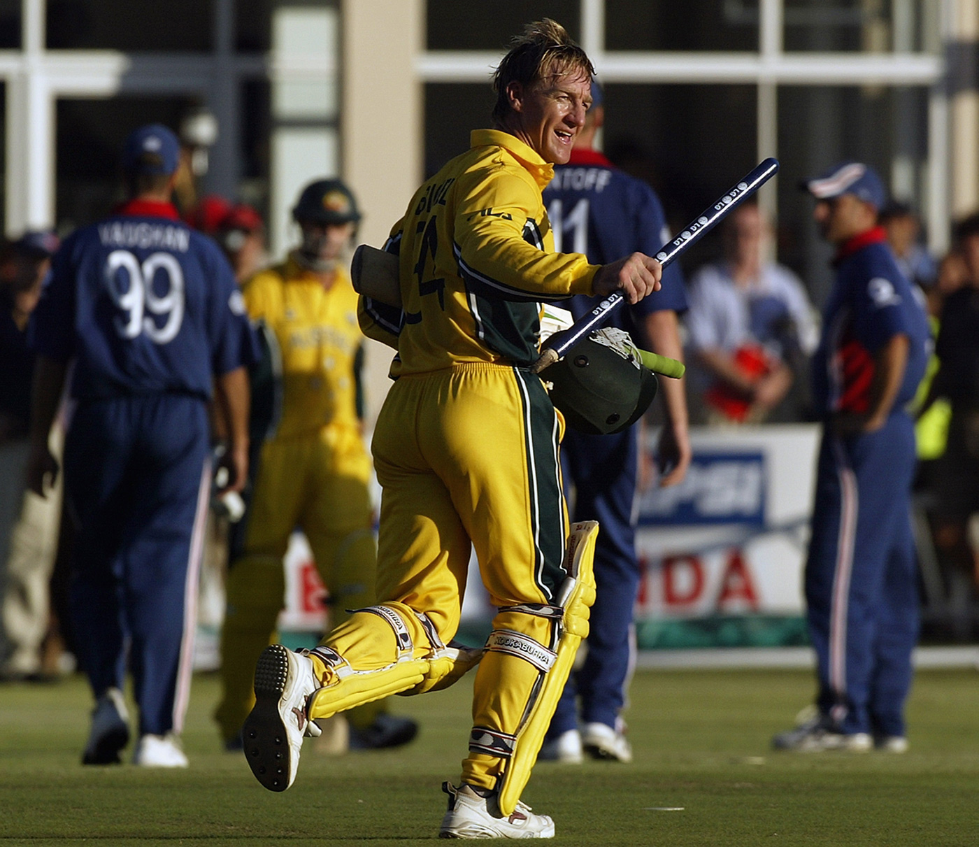 Andy Bichel runs holding a stump after Australia's victory