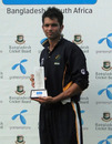 Keshav Maharaj poses with his richly-deserved Man-of-the-Match award, BCB Academy v SA Academy, 2nd one-dayer, Bogra, May 6, 2010
