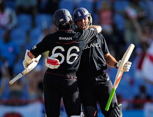 Tim Bresnan and Graeme Swann embrace as England complete a comfortable three-wicket victory