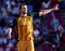 Dirk Nannes celebrates the early wicket of Chris Gayle