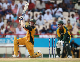 Michael Hussey targets Saeed Ajmal in the decisive final over of an absorbing contest