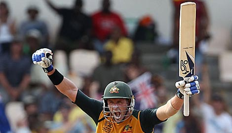 Michael Hussey celebrates after the heist