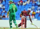 Darren Sammy was stumped by AB de Villiers when he wandered too far out of his crease to a wide