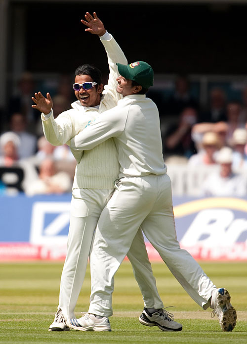 Substitute fielder Shamsur Rahman is congratulated after Matt Prior's run out