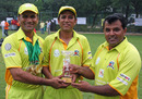Winning Smiles - Pakistan Association's victorious captain Ilyas Gull (centre) is flanked by joint Players of the Tournament Najeeb Amar (left) and Muhammad Imran (right) after the awards ceremony at the Quaid-e-Azam Trophy 2010