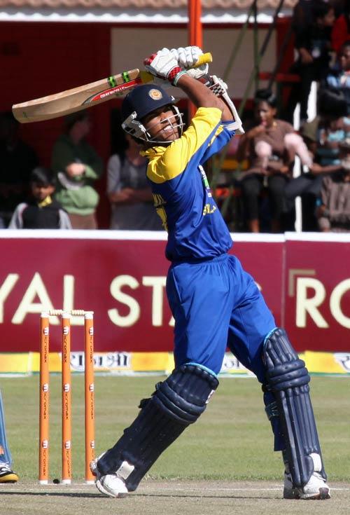 Dinesh Chandimal clobbers the ball over long-on