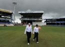 Umpires Steve Davis and Asad Rauf inspect the pitch before the start of play