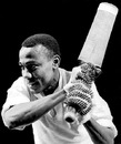 Conrad Hunte poses with a bat, May 19, 1963