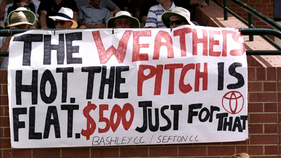 Spectators display a banner referring to the betting scandal involving Mark Waugh and Shane Warne