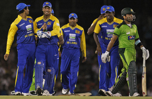 Sri Lanka's fielders celebrate the dismissal of Umar Akmal