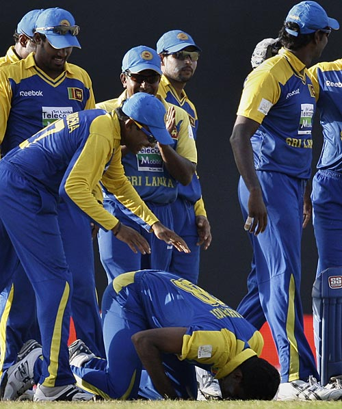 The Sri Lankans gather around hat-trick hero Farveez Maharoof