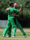 Nigel Jones and John Mooney celebrate another wicket