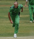 Ireland's Trent Johnston in his follow through