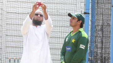 Former Pakistan offspinner Saqlain Mushtaq gives Saeed Ajmal some bowling tips