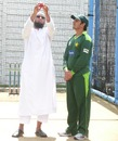Former Pakistan offspinner Saqlain Mushtaq gives Saeed Ajmal some bowling tips, Leicester, July 9, 2010