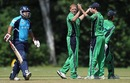 Kevin O'Brien celebrates the wicket of Omer Hussain, Ireland v Scotland, ICC World Cricket League Division 1 final, Amstelveen, July 10, 2010