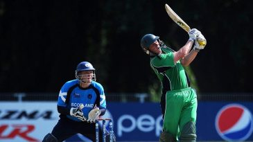 Kevin O'Brien launches a six over the leg side