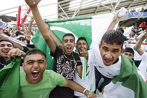 Pakistani fans cheer for their side