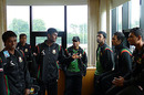 Jahurul Islam chats with his team-mates as the players are forced indoors