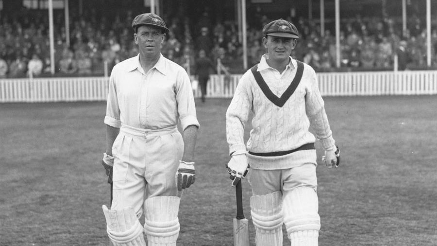 Bill Ponsford and Stan McCabe (right) walk out to bat