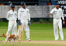 Rahul Dravid, MS Dhoni and VVS Laxman watch a dog walk across the ground, Sri Lanka Board President's XI v Indians, 3rd day, Colombo, July 15, 2010