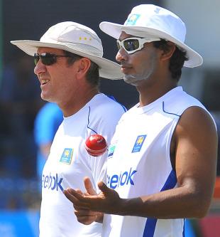 Coach Trevor Bayliss and Kumar Sangakkara keep an eye on the training session