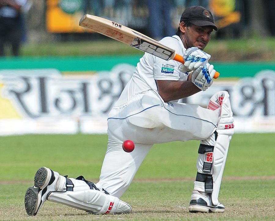 Kumar Sangakkara sweeps the ball