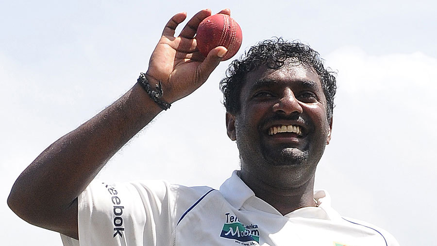 Muttiah Muralitharan salutes the crowd with the ball that fetched him his 800th wicket