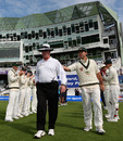 Rudi Koertzen walks through the guard of honour given to him by the players for his final morning as a Test umpire, Pakistan v Australia, 2nd Test, Headingley, 4th day, July 24 2010
