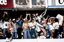 West Indies fans celebrate the fall of an Australian wicket