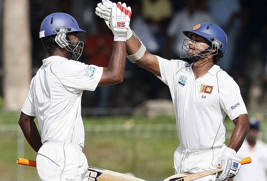 Kumar Sangakkara celebrates his century with Tharanga Paranavitana