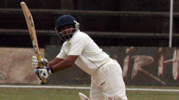 Kedar Devdhar tucks the ball to the leg side on his way to 54
