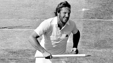 Ian Botham races back to the pavilion with a souvenir stump