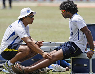 Lasith Malinga with Sri Lanka's physio Tommy Simsek on the eve of the third Test against India at the P Sara Oval in Colombo