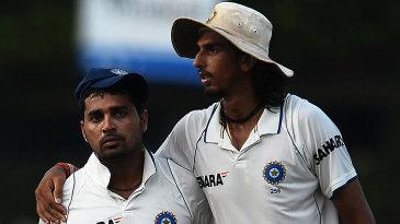 M Vijay and Ishant Sharma walk back after India claimed two wickets