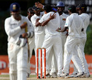 Suraj Randiv is mobbed by his teammates after getting Virender Sehwag for a duck