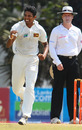 Suraj Randiv celebrates after dismissing Ishant Sharma