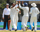 Suraj Randiv celebrates Ishant Sharma's dismissal with his team-mates