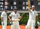 VVS Laxman celebrates his century with Suresh Raina and runner Virender Sehwag