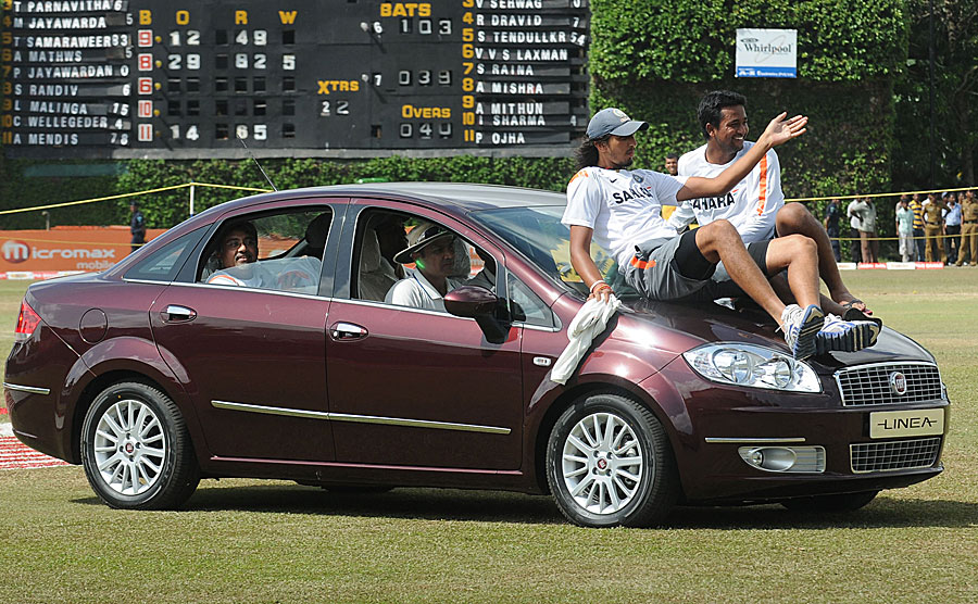 Virender Sehwag drives his Man-of-the-Series prize with his team-mates piling on wherever possible