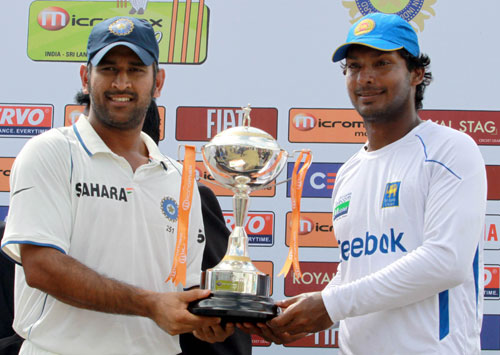 MS Dhoni and Kumar Sangakkara pose with the series trophy