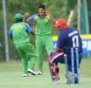 Harsh Ramaiya celebrates the dismissal of Kevin Bazil, Cayman Islands v Tanzania, ICC WCL Div. 4, Pianoro, August 18, 2010