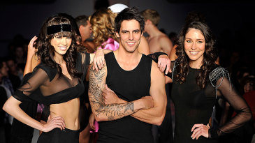 Mitchell Johnson shows off his tattoo at the Rosemount Sydney Fashion Festival