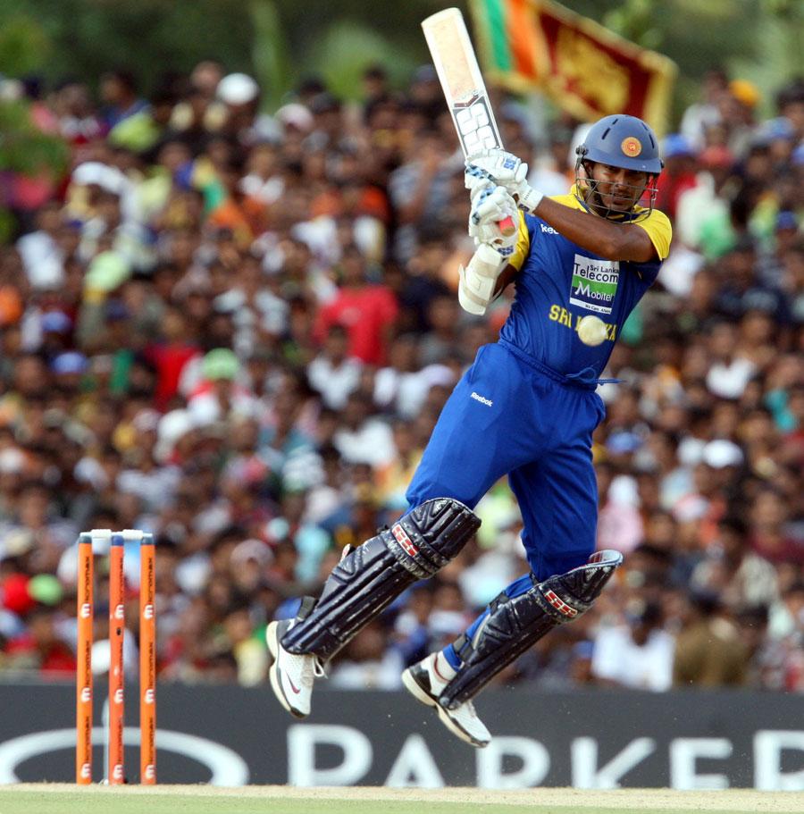 Kumar Sangakkara is airborne as he pulls the ball