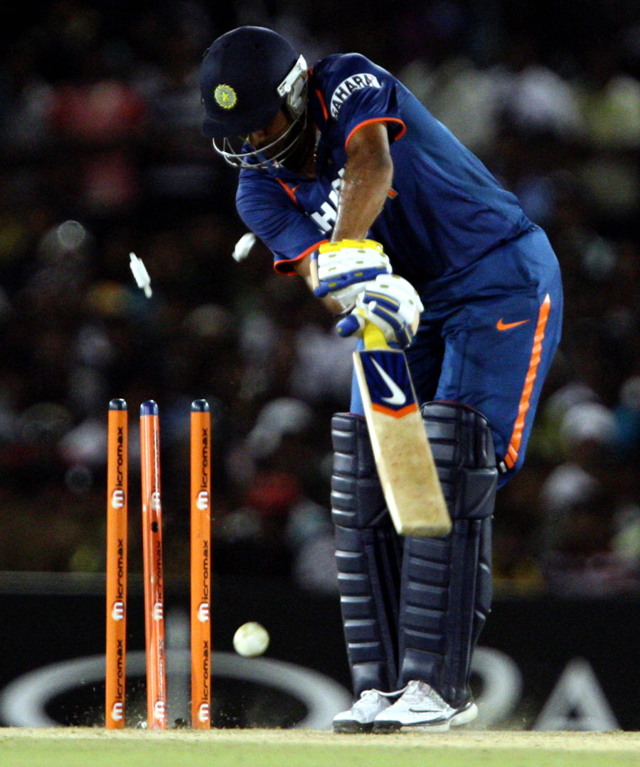 Praveen Kumar is bowled by a Lasith Malinga yorker