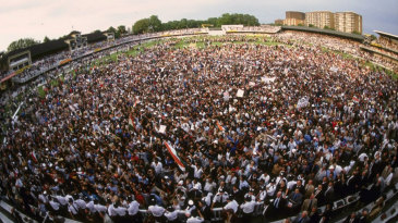 Indian fans celebrate the win