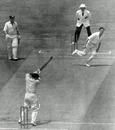 Les Favell cuts a ball Brian Statham as his team-mate Arthur Morris looks on, Australia v England, 3rd Test, MCG, 2nd day, January 1, 1955